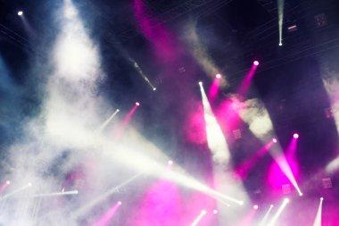 Spotlights illuminating the stage