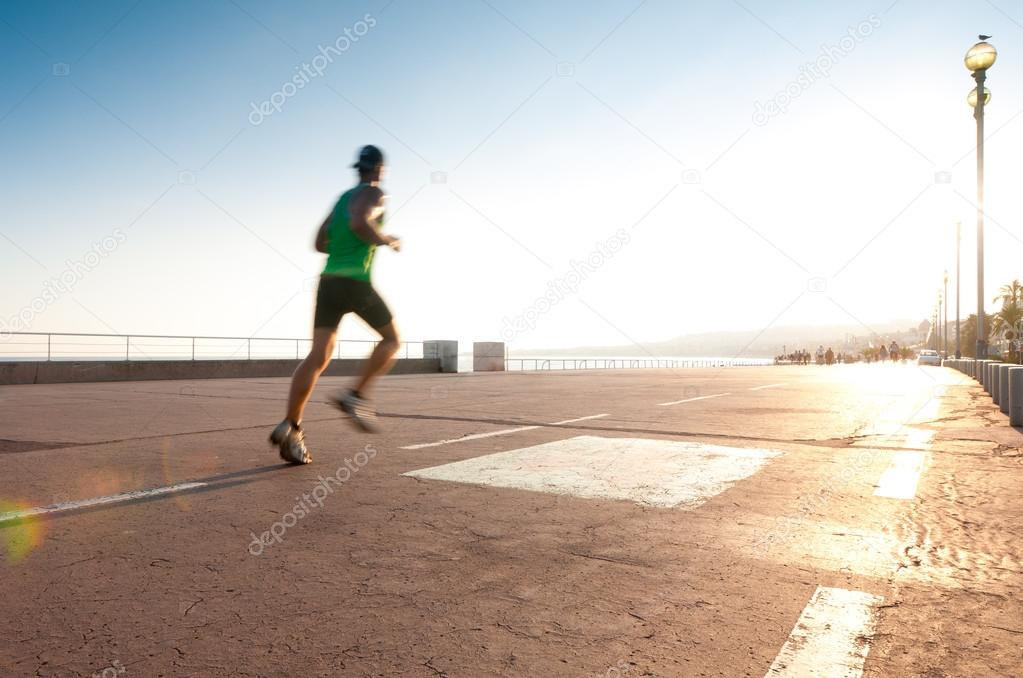 Man running at the seaside.