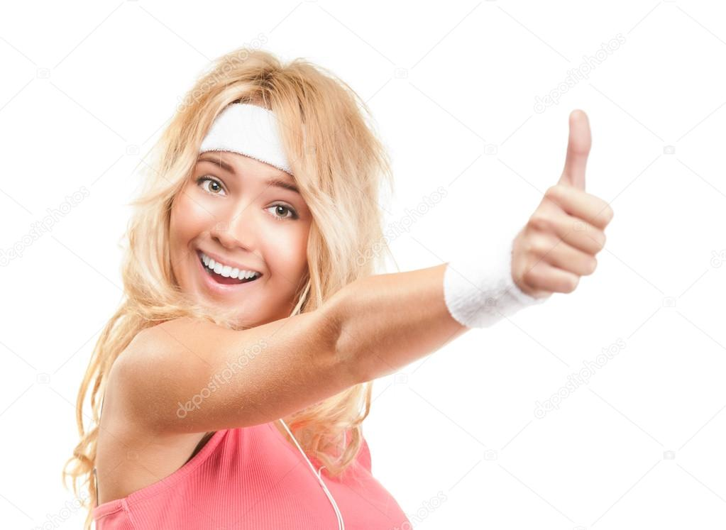 Portrait of beautiful young sporty woman isolated on white background. Happy and excited girl expressing success or victory with thumbs up sign. Healthy lifestyle.