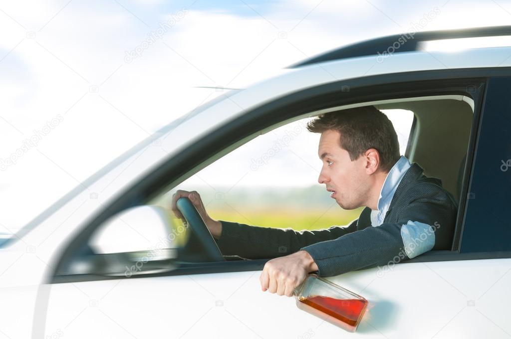 Drunk Man Driving Car With Bottle In Hand Stock Photo Kyolshin