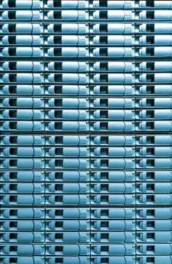 Seamless blue background of server disk storage.