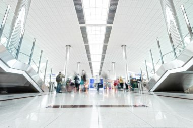 Modern airport hall with passengers in Dubai.