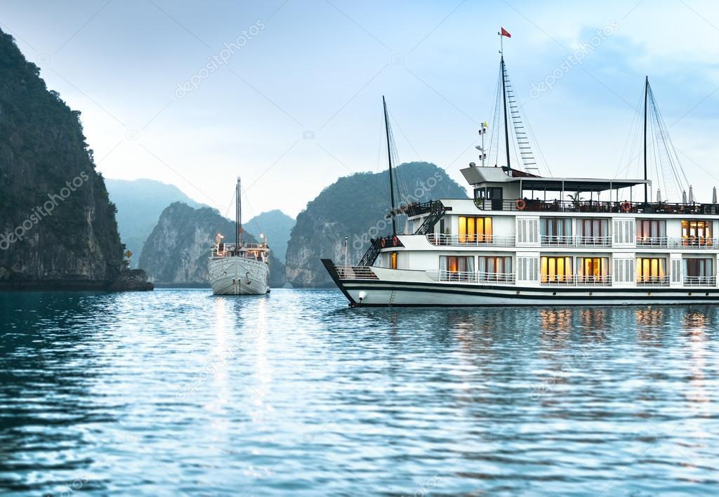 Two ships in beautiful Halong bay, Vietnam, Asia.
