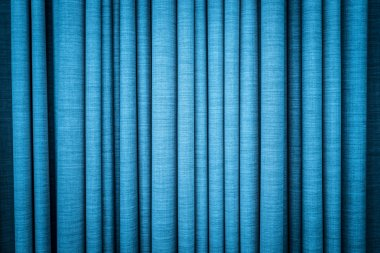 Blue curtain in folds. Textured background.