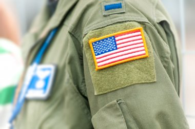 Focus on american flag on USAF uniform of person.