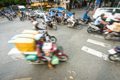 Photo Stream of bikes in busy street