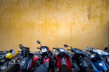 Bikes parked near building with grungy wall