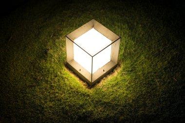 Lighting cube lantern on grass
