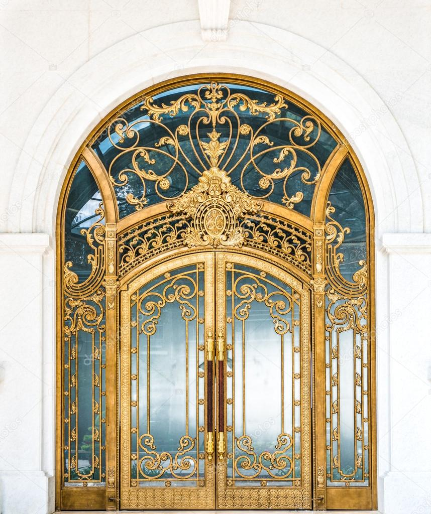 Door with gold ornate pattern