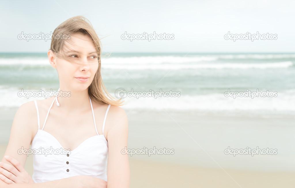 Pretty woman on beach looking somewhere
