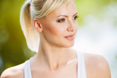 Close up portrait of a smiling healthy blonde woman