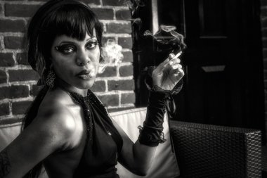 Sexy black gothic woman smoking