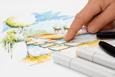 Landscape Architect showing Detail on Blueprint