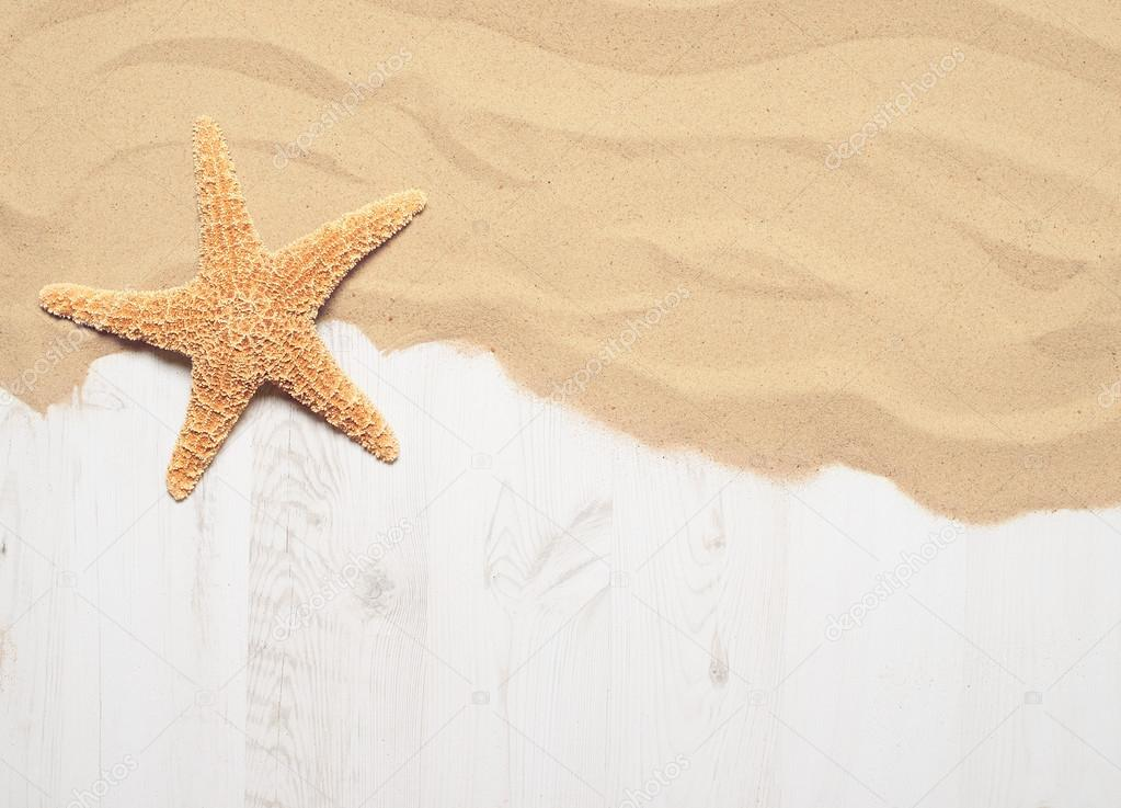 Sand on wooden decking with starfish
