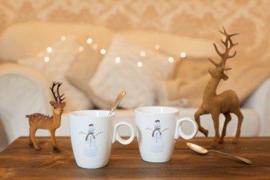 Christmas tea break with reindeer decorations in living room stock vector