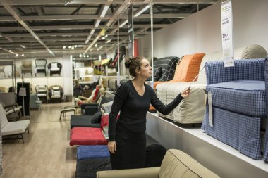 Woman shopping for furniture