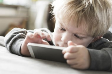 Boy playing games on smartphone