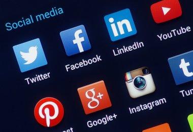 Social media icons on smartphone screen. Closeup of popular social media logo's. stock vector