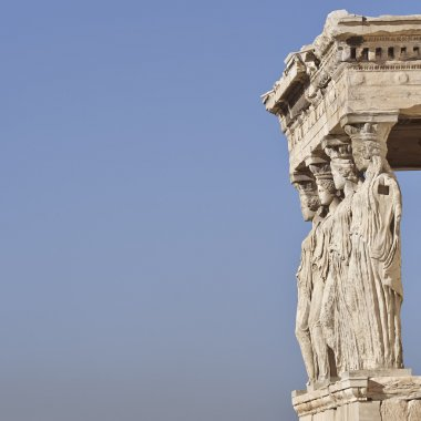 Caryatides ancient Greek statues, and blue sky as space for text