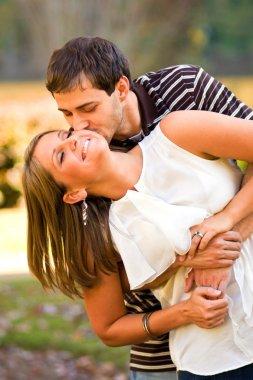 Lovestruck Couple Playfully Embrace