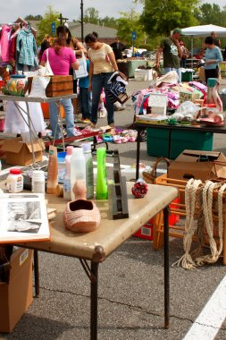 Shoppers Look Through Merchandise At City Garage Sale