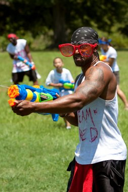 Muscular Young Man Squirts With Water Gun