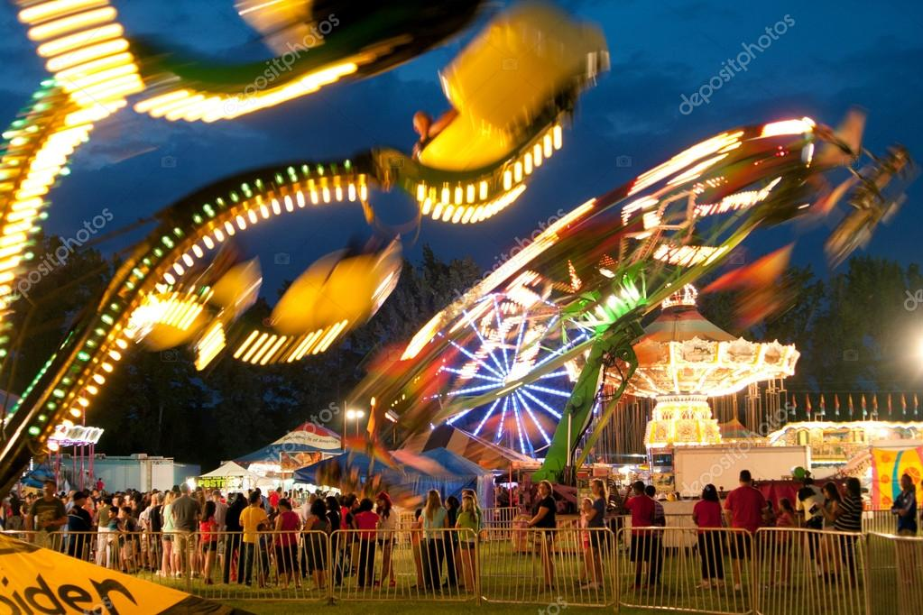 Colorful Lights Of Carnival Rides Motion Blur At Fair