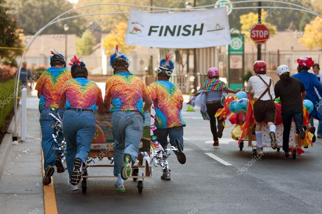 Teams Push Beds Toward Finish Line Of Mattress Race