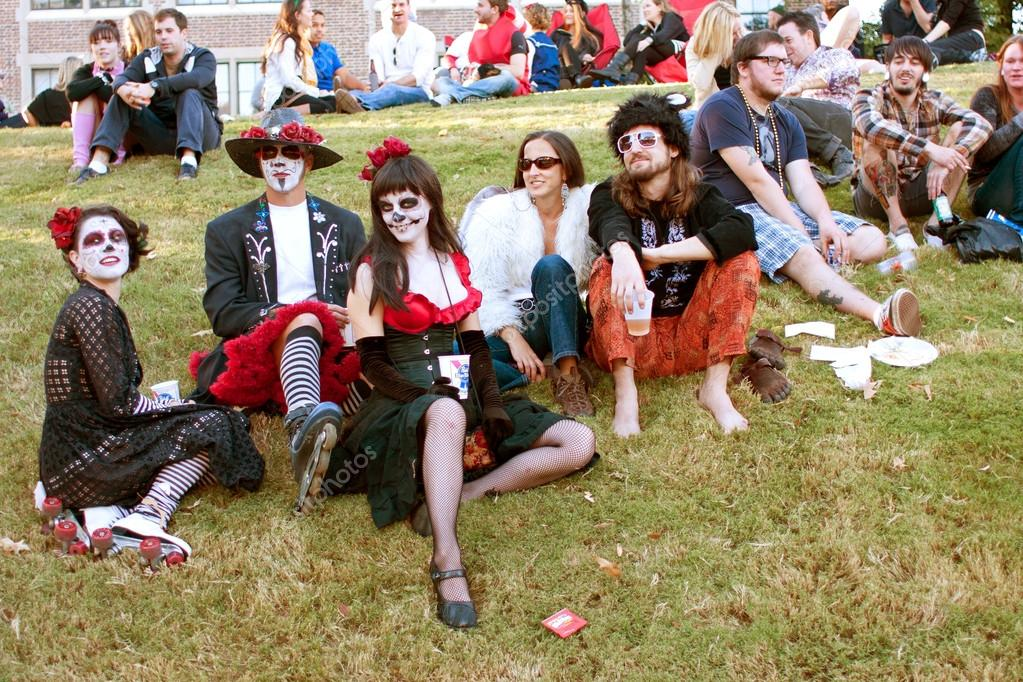Hippie Zombies Relax And Drink Beer After Halloween Parade