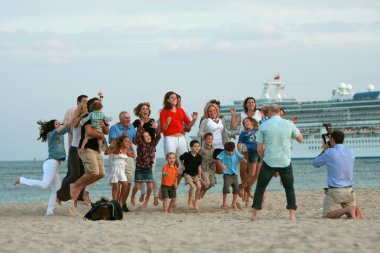 Large Family Jumps In Air While Photographer Takes Photo