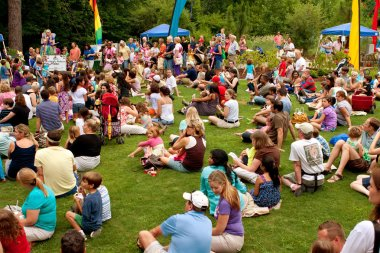 Crowd Sits And Waits For Release of Butterflies At Festival