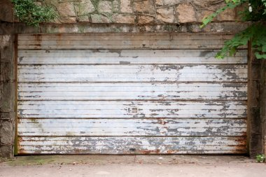 Vintage Garage Door Covered With Rust And Chipped Paint