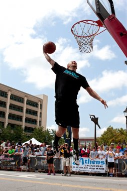 Man Leaps To Jam Basketball In Outdoor Slam Dunk Contest