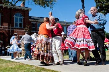 Senior Citizens Square Dance At Outdoor Event