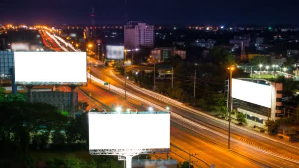 Time lapse long highway and three big billboard day to night