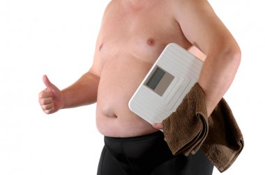 Fat man with bathroom scale