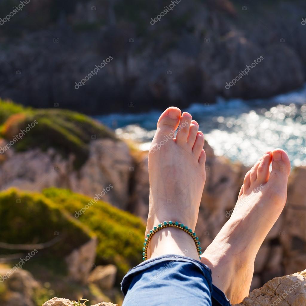 Vacation holidays. Woman feet. Relaxing enjoying sun.