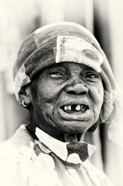An old Ghanaian lady without some teeth