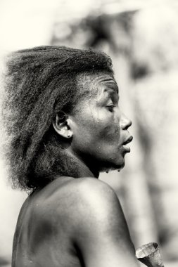 Woman from Togo sweats after dance