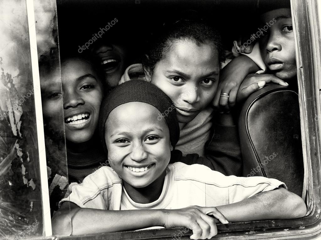 Four smiling children of Madagascar