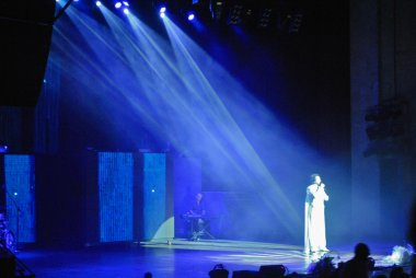 Filipp Kirkorov, Russian pop singer, performs his famous song in the light