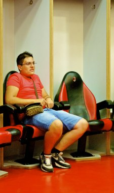 A man sits in the chair