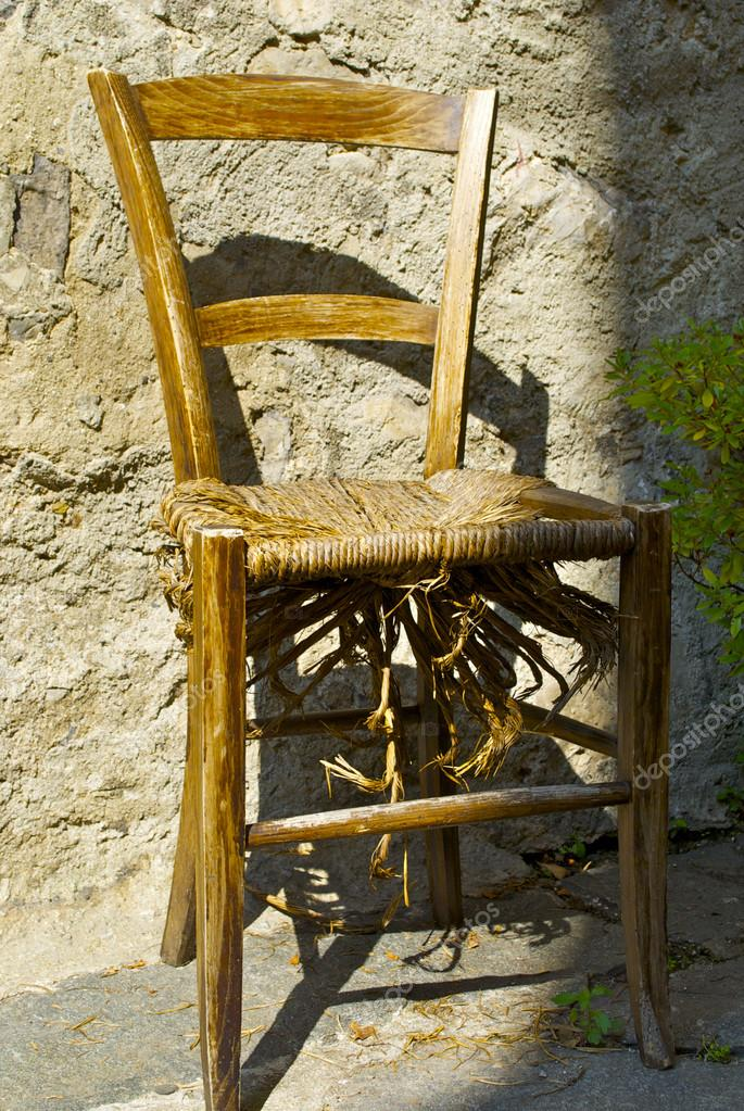 Old Broken Chair Near The House Of Town On Mountain Hill Called Gandria