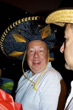 Happy guy in sombrero from Mexico