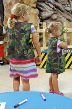 Cute little girls in camouflage