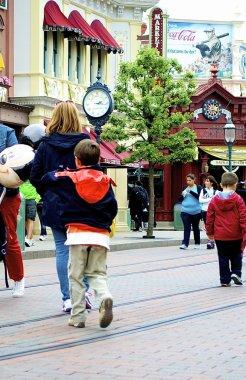Little boy runs in the Disneyland