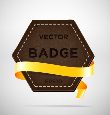 Vector vintage leather hexagonal badge with yellow silky ribbon