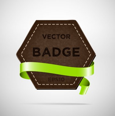Vector vintage leather hexagonal badge with green silky ribbon