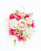Photo plastic flower on white background
