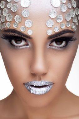 Sensual woman with rinhstone make up toned image